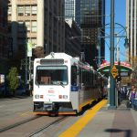 Riders (alongside pedestrians) getting off a RTD Light Rail Train near 16th street in Downtown Denver.  The RTD Light Rail system serves the Denver Metropolitan Area and has 5 lines and 39.4 miles of track, and has a daily ridership of 63,100 people.