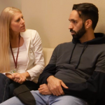 Man speaking with behavioral health clinician